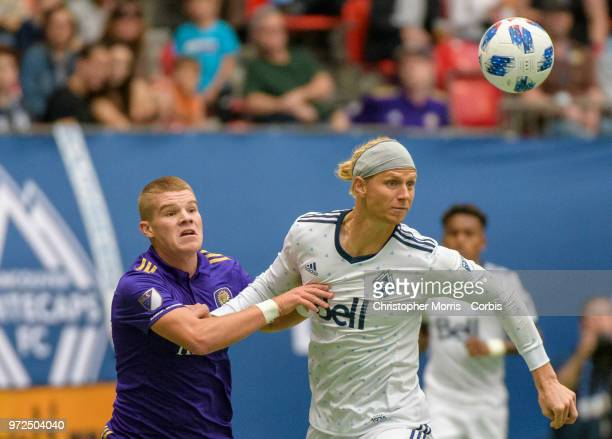 Chris Mueller of Orlando City and Brek Shea of the Vancouver Whitecapsbattle fight for the ball during a match between Orlando City SC and Vancouver...