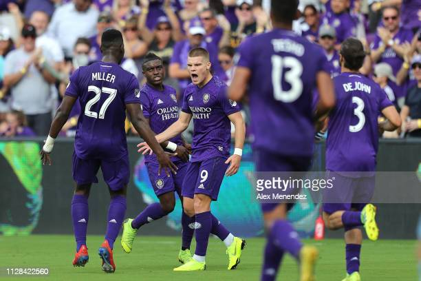 Chris Mueller of Orlando City celebrates his goal with teammates Kamal Miller Tesho Akindele and Alex De John of Orlando City during a MLS soccer...