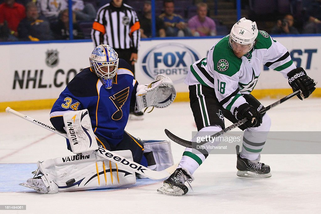 Chris Mueller #18 of the Dallas Stars takes a shot on goal against Jake Allen #34 of the St. Louis Blues during a preseason at the Scottrade Center on September 21, 2013 in St. Louis, Missouri.