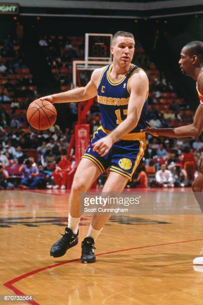 Chris Mullin of the Golden State Warriors dribbles against the Atlanta Hawks during a game played circa 1990 at the Omni in Atlanta Georgia NOTE TO...
