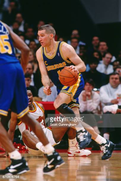 Chris Mullin of the Golden State Warriors drives against the Atlanta Hawks during a game played circa 1995 at the Omni in Atlanta Georgia NOTE TO...