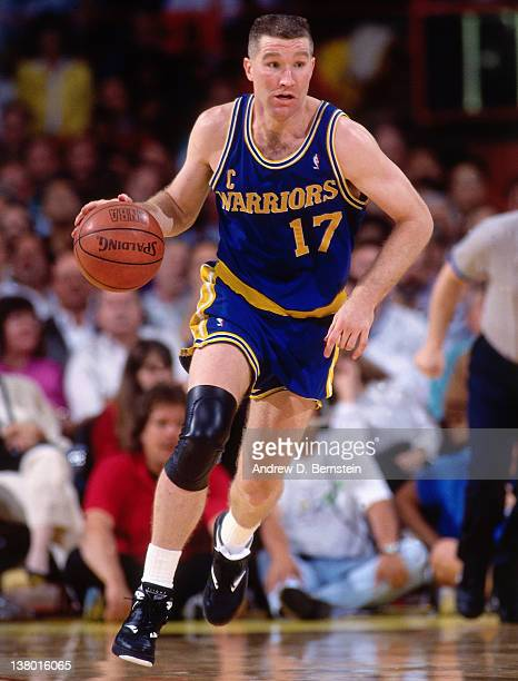 Chris Mullin of the Golden State Warriors drives against the Los Angeles Lakers circa 1991 at The Great Western Forum in Inglewood California NOTE TO...