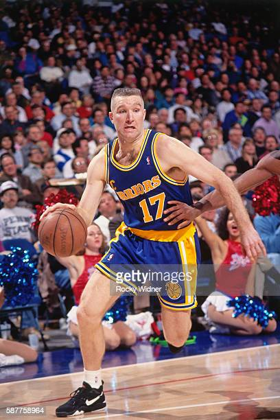 Chris Mullin of the Golden State Warriors drives to the basket against the Sacramento Kings circa 1994 at Arco Arena in Sacramento California NOTE TO...