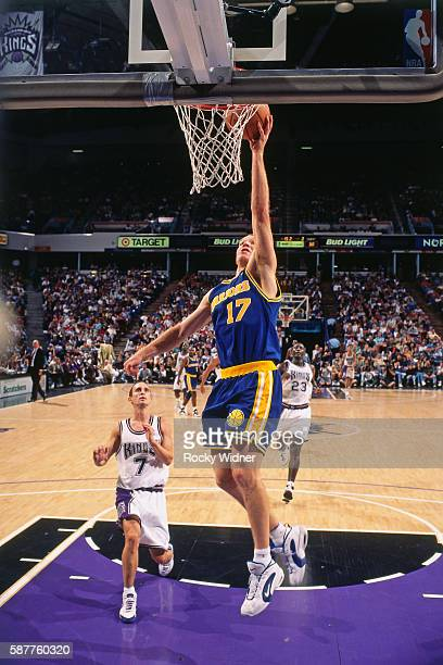Chris Mullin of the Golden State Warriors goes to the basket against the Sacramento Kings circa 1996 at Arco Arena in Sacramento California NOTE TO...