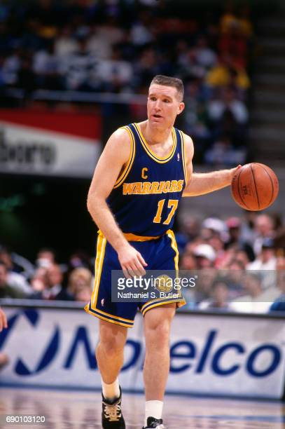 Chris Mullin of the Golden State Warriors handles the ball during the game against the New Jersey Nets circa 1993 at the Brendan Byrne Arena in East...