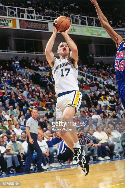 Chris Mullin of the Golden State Warriors shoots against the New Jersey Nets circa 1997 at San Jose Arena in San Jose California NOTE TO USER User...
