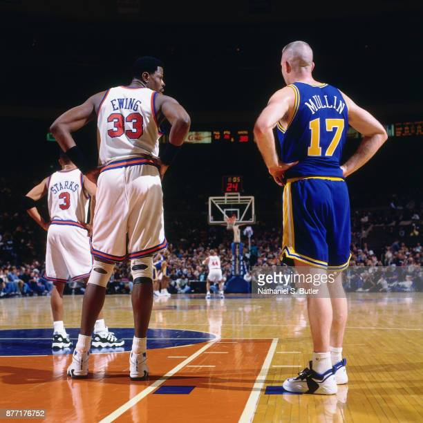 Chris Mullin of the Golden State Warriors stands with Patrick Ewing of the New York Knicks during a game played on March 3 1996 at Madison Square...