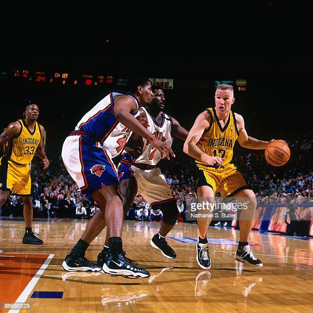 Chris Mullin of the Indiana Pacers looks to make a move against Larry Johnson and Kurt Thomas of the New York Knicks in Game Six of the Eastern...