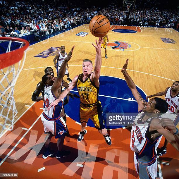 Chris Mullin of the Indiana Pacers shoots a layup against Marcus Camby and Kurt Thomas of the New York Knicks in Game Four of the Eastern Conference...
