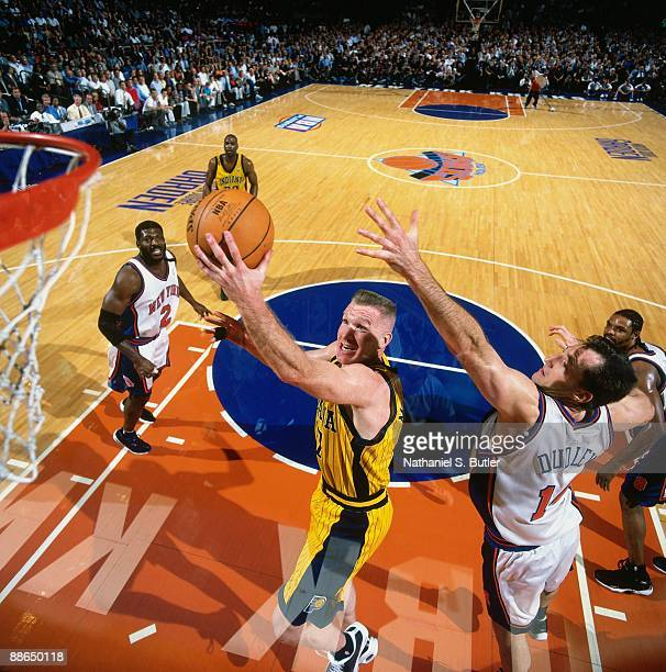Chris Mullin of the Indiana Pacers shoots against Chris Dudley of the New York Knicks in Game Four of the Eastern Conference Finals during the 1999...