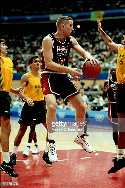 Chris Mullin of the USAB Dream Team passes behind his back as he hangs in the air during the 1992 Olympics in Barcelona Spain NOTE TO USER User...