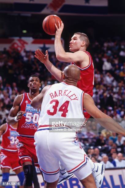Chris Mullin of the Western Conference shoots against Charles Barkley of the Eastern Conference during the NBA AllStar Game at the Charlotte Coliseum...