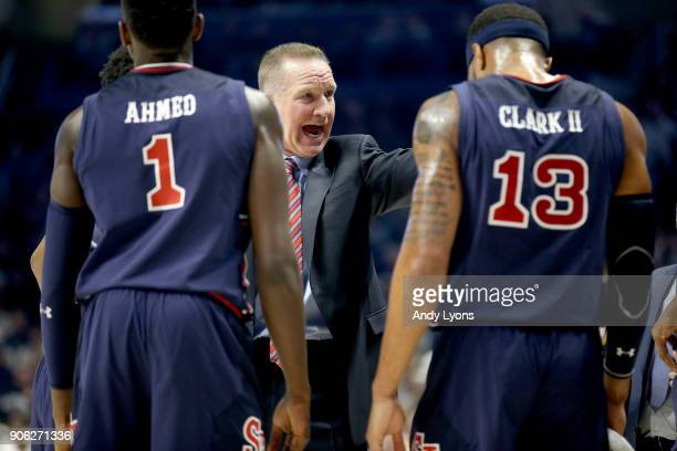 Chris Mullin the head coach of the St John's Red Storm gives instructions to his team against the Xavier Musketeers during the game at Cintas Center...