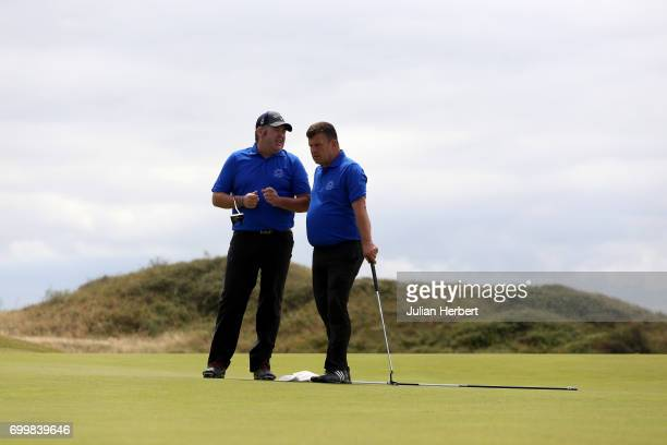 Chris Murphy and Carl Curtis of Raglan Parc Golf Club on the 17th green during The Lombard Trophy South West Qualifier at Burnham and Berrow Golf...