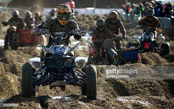 Chris Murphy rides his quad bike along a straight during the main quad and sidecar race during the 2012 RHL Weston beach race in WestonSuperMare...