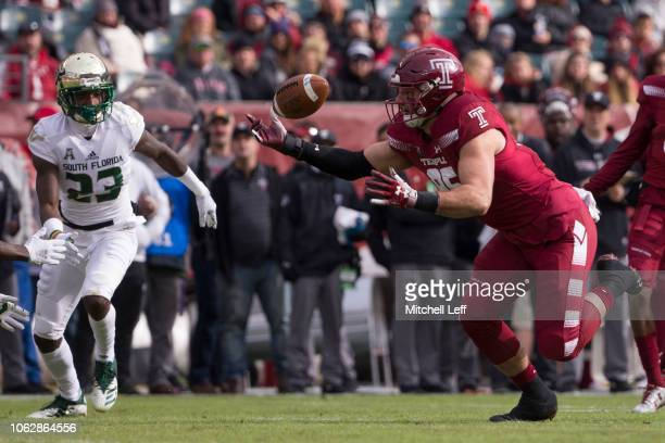 Chris Myarick of the Temple Owls catches a pass in front of Mazzi Wilkins of the South Florida Bulls in the first quarter at Lincoln Financial Field...