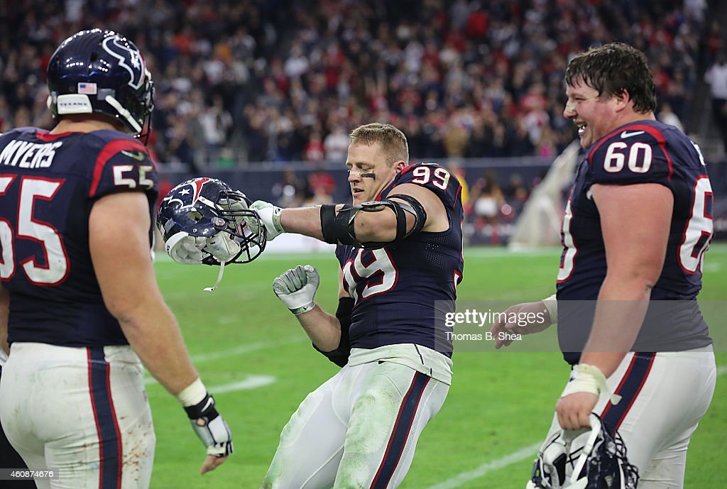 Chris Myers #55 and Ben Jones #60 watch J.J. Watt #99 of the Houston Texans celebrates his sack against Blake Bortles #5 of the Jacksonville Jaguars in the fourth quarter in a NFL game on December 28, 2014 at NRG Stadium in Houston, Texas. It was Watt's 20th sack for the season.