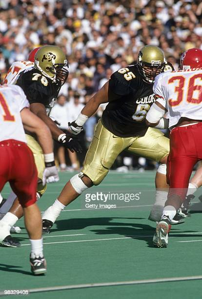 Chris Naeole of the Colorado Buffalos moves on the field against Iowa State Cyclones at Folsom Field on November 91996 in Boulder Colorado