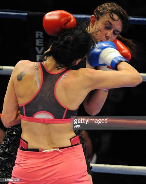Chris Namus of Uruguay exchanges blows with Maria Loli Munoz of Spain in their WPBF light welterweight world title fight in Montevideo late on June...