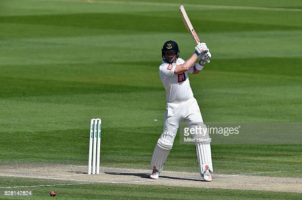 Chris Nash of Sussex cuts for four to bring up his century on the fourth day of the Specsavers County Championship Division Two match between Sussex...