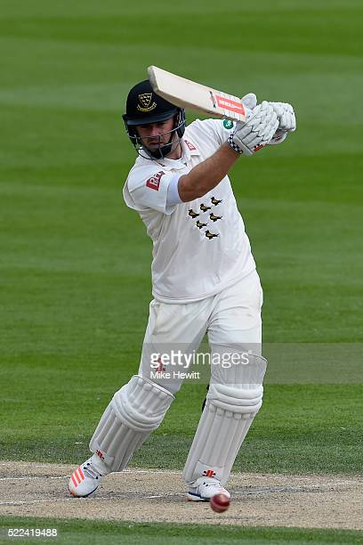 Chris Nash of Sussex drives a ball from Jamie Porter of Essex to the boundary during the Specsavers County Championship Division Two match between...