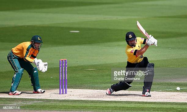 Chris Nash of Sussex hits out while Chris Read of Nottinghamshire looks on during the Royal London OneDay Cup match between Sussex and...