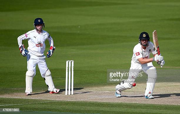 Chris Nash of Sussex hits out while Hampshire's Adam Wheater looks on during day two of the LV County Championship match between Sussex and Hampshire...