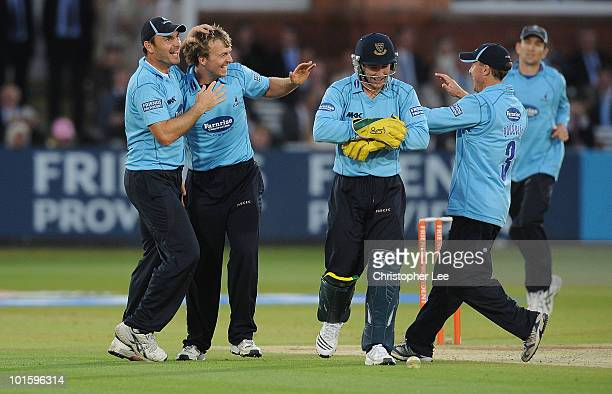 Chris Nash of Sussex is congratulated after taking the wicket of Gareth Berg of Middlesex during the Friends Provident Twenty20 match between...