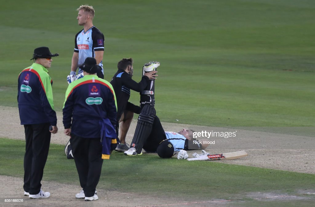 Chris Nash of Sussex receives treatment for cramp during the Sussex v Essex - NatWest T20 Blast (G) cricket match at the 1st Central County Ground on August 18, 2017 in Hove, England.