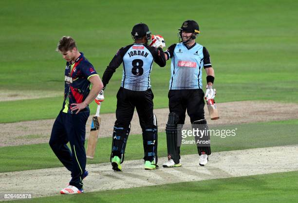 Chris Nash of Sussex Sharks celebrates with teammate Chris Jordan after scoring the winning runs off the bowling of Jimmy Neesham of Kent Spitfires...