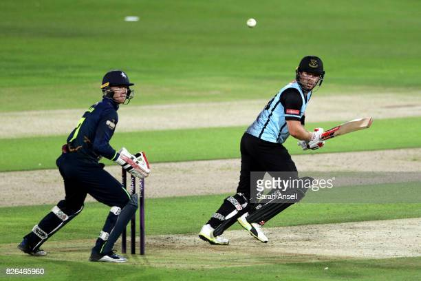 Chris Nash of Sussex Sharks hits out as Kent Spitfires wicket keeper Sam Billings looks on during the match between Kent Spitfires and Sussex Sharks...