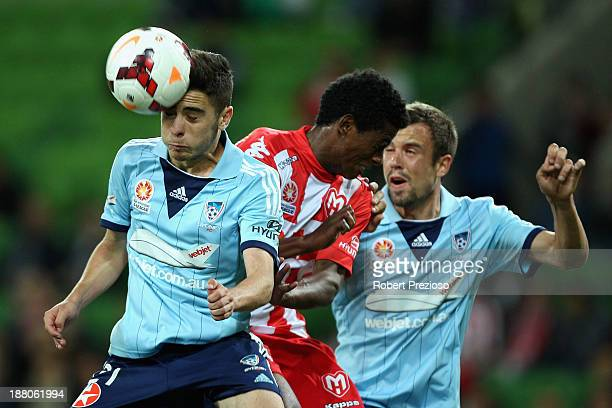 Chris Naumoff of Sydney heads the ball out of defence during the round six ALeague match between the Melbourne Heart and Sydney FC at AAMI Park on...