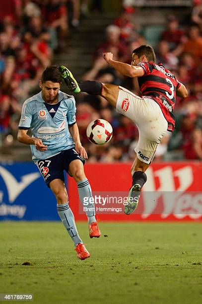 Chris Naumoff of Sydney is kicked in the head by Adam D'apuzzo of the Wanderers during the round 14 ALeague match between the Western Sydney...