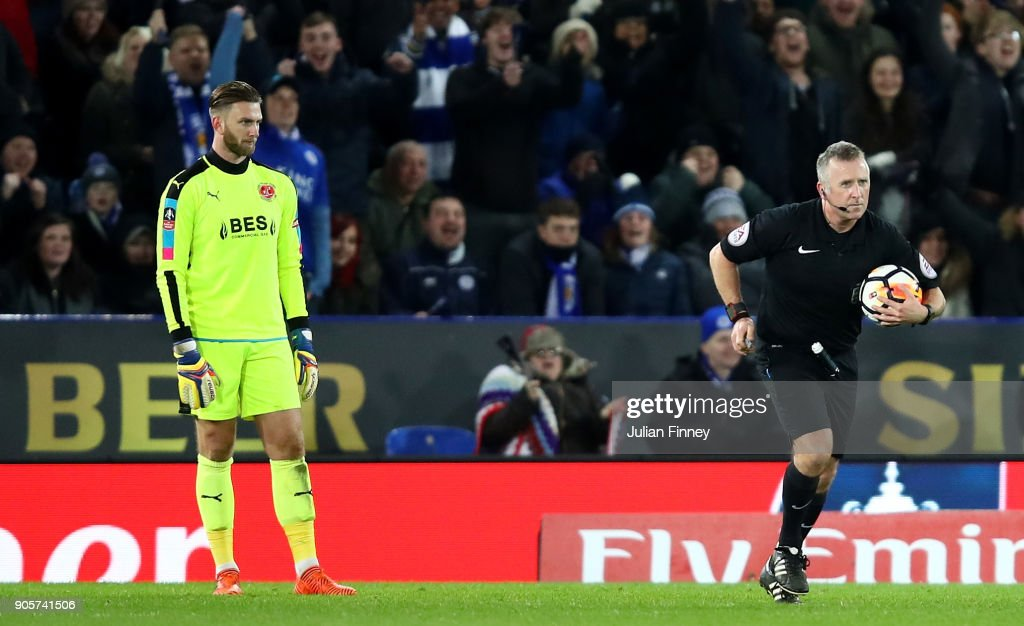 Chris Neal of Fleetwood Town looks on as referee Jon Moss awards Leicester City their second goal following a VAR decision during The Emirates FA Cup Third Round Replay match between Leicester City and Fleetwood Town at The King Power Stadium on January 16, 2018 in Leicester, England. The goal was initally disallowed, but was awarded following a VAR decision.