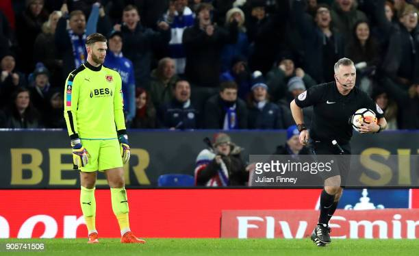 Chris Neal of Fleetwood Town looks on as referee Jon Moss awards Leicester City their second goal following a VAR decision during The Emirates FA Cup...