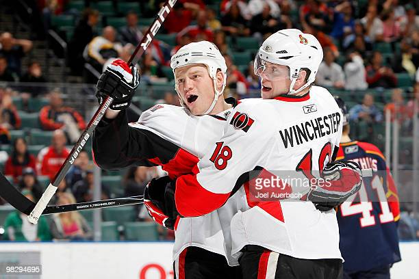 Chris Neil is congratulated by Jesse Winchester of the Ottawa Senators after scoring a goal against the Florida Panthers on April 6 2010 at the...