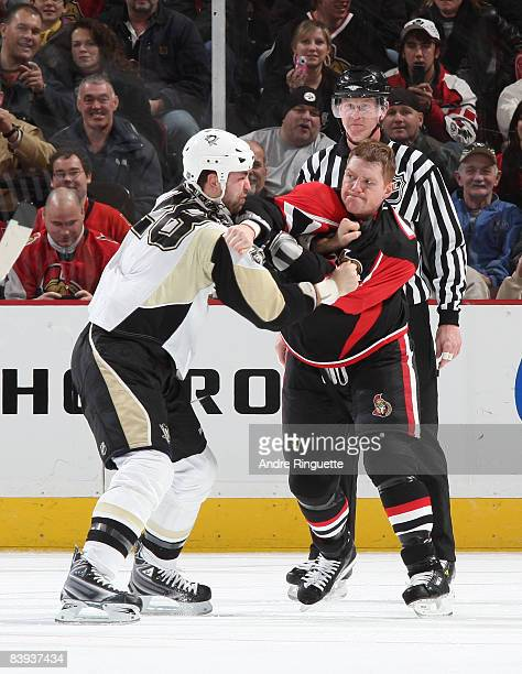 Chris Neil of the Ottawa Senators and Eric Godard of the Pittsburgh Penguins fight during second period action at Scotiabank Place on December 6,...