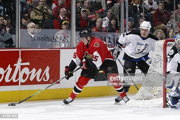 Chris Neil of the Ottawa Senators attempts a wraparound against defenseman Nolan Pratt and goaltender John Grahame of the Tampa Bay Lightning during...