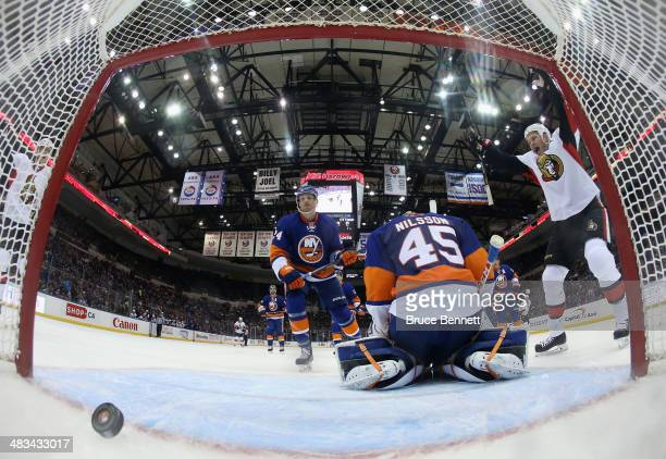 Chris Neil of the Ottawa Senators celebrates a power play goal by Jason Spezza against Anders Nilsson of the New York Islanders during the second...