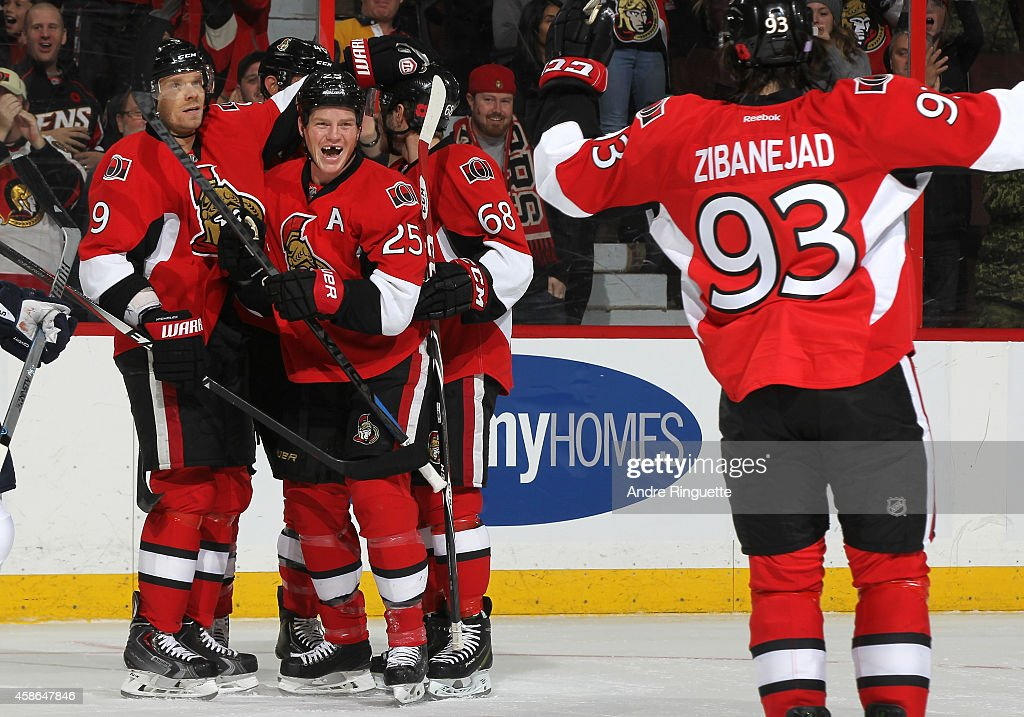 Chris Neil #25 of the Ottawa Senators celebrates his first period power-play goal against the Winnipeg Jets with teammates Milan Michalek #9, Mike Hoffman #68 and Mika Zibanejad #93 at Canadian Tire Centre on November 8, 2014 in Ottawa, Ontario, Canada.