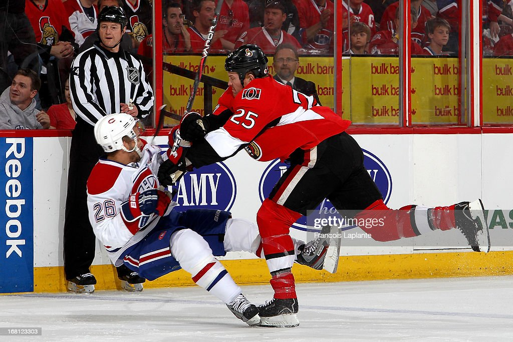 Chris Neil #25 of the Ottawa Senators checks Josh Gorges #26 of the Montreal Canadiens in Game Three of the Eastern Conference Quarterfinals during the 2013 NHL Stanley Cup Playoffs at Scotiabank Place on May 5, 2013 in Ottawa, Ontario, Canada.