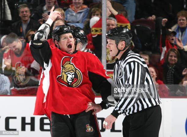 Chris Neil of the Ottawa Senators gestures to pump up the crowd after a fight in a game against the Tampa Bay Lightning at Scotiabank Place on...