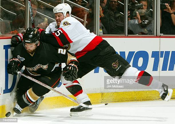Chris Neil of the Ottawa Senators hits Francois Beauchemin of the Anaheim Ducks during Game Five of the 2007 Stanley Cup finals against the Anaheim...