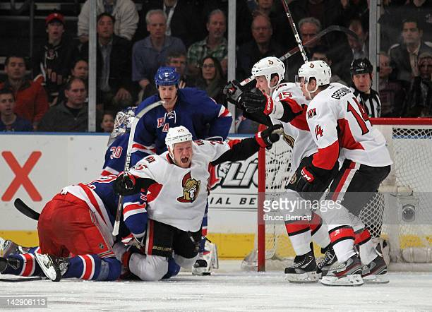 Chris Neil of the Ottawa Senators scores the overtime winning goal at 1:17 of overtime against the New York Rangers and is joined by Zack Smith and...