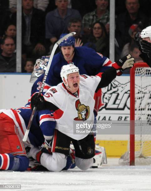 Chris Neil of the Ottawa Senators scores the overtime winning goal at 117 of overtime against the New York Rangers in Game Two of the Eastern...