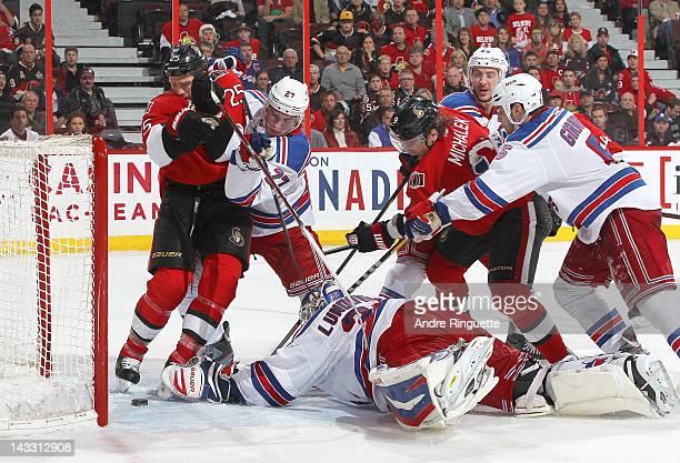 Chris Neil of the Ottawa Senators watches the puck pass as Jason Spezza of the Ottawa Senators scores a goal against Henrik Lundqvist, Ryan McDonagh,...