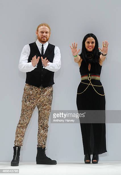 Chris Neuman and Virginia Ferreira walk the runway at the Belle Sauvage show at the Fashion Scout venue during London Fashion Week AW14 at Freemasons...