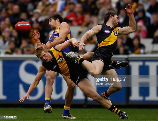 Chris Newman and David Astbury of the Tigers collide as they compete for the ball during the round 12 AFL match between the Richmond Tigers and the...