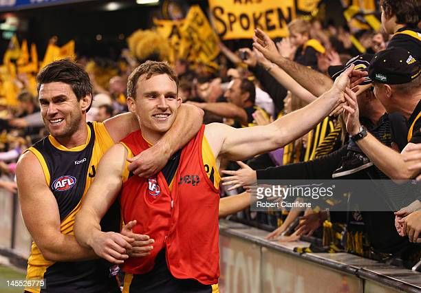 Chris Newman and Nathan Foley of the Tigers celebrate after the Tigers defeated the Saints at the round 10 AFL match between the St Kilda Saints and...