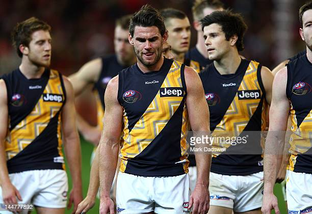 Chris Newman captain of the Tigers leads his team off after their loss in the round eight AFL match between the Essendon Bombers and the Richmond...